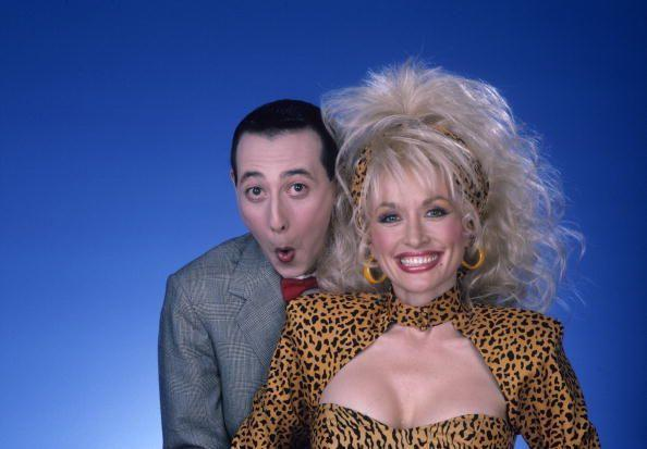 <p>Parton channels her inner cheetah while posing with Paul Reubens (aka Pee Wee Herman), a guest on the ABC variety show she hosted from 1987 to 1988. </p>