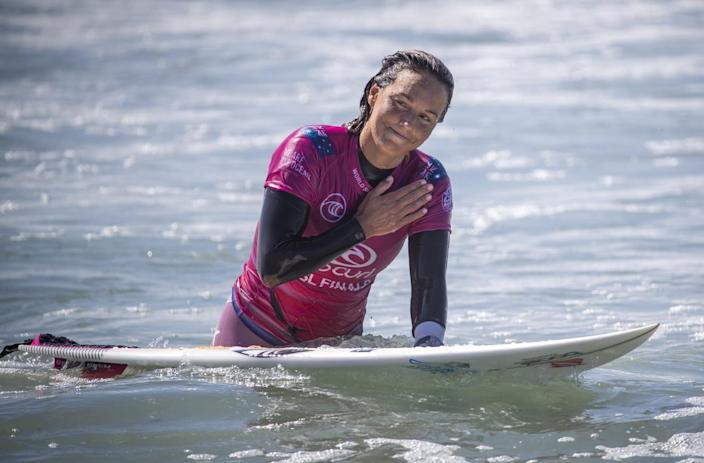 Sally Fitzgibbons of Australia holds a hand to her heart after her defeat by Tatiana Weston-Webb.