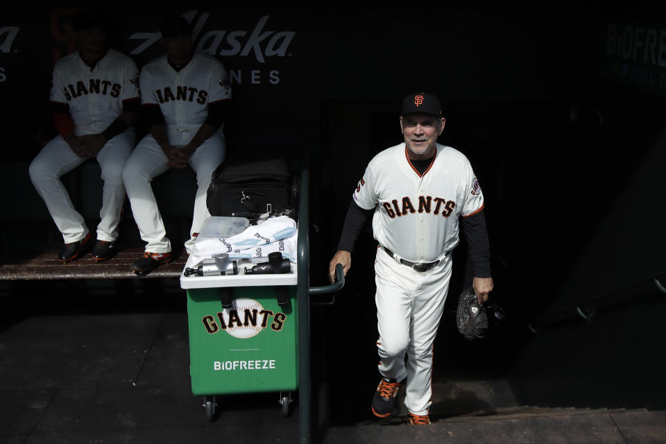 San Francisco Giants manager Bruce Bochy walks into the dugout before a baseball game between the Giants and the Los Angeles Dodgers in San Francisco, Sunday, Sept. 29, 2019. (AP Photo/Jeff Chiu)