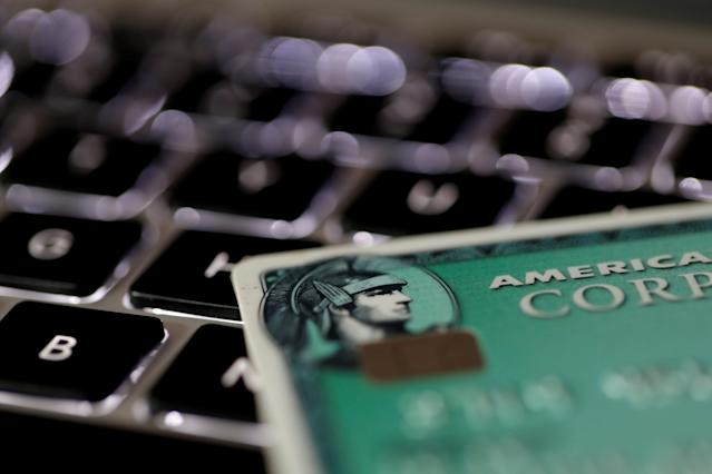 (An American Express credit card is seen on a computer keyboard in this picture illustration taken September 6, 2017. REUTERS/Philippe Wojazer/Illustration)