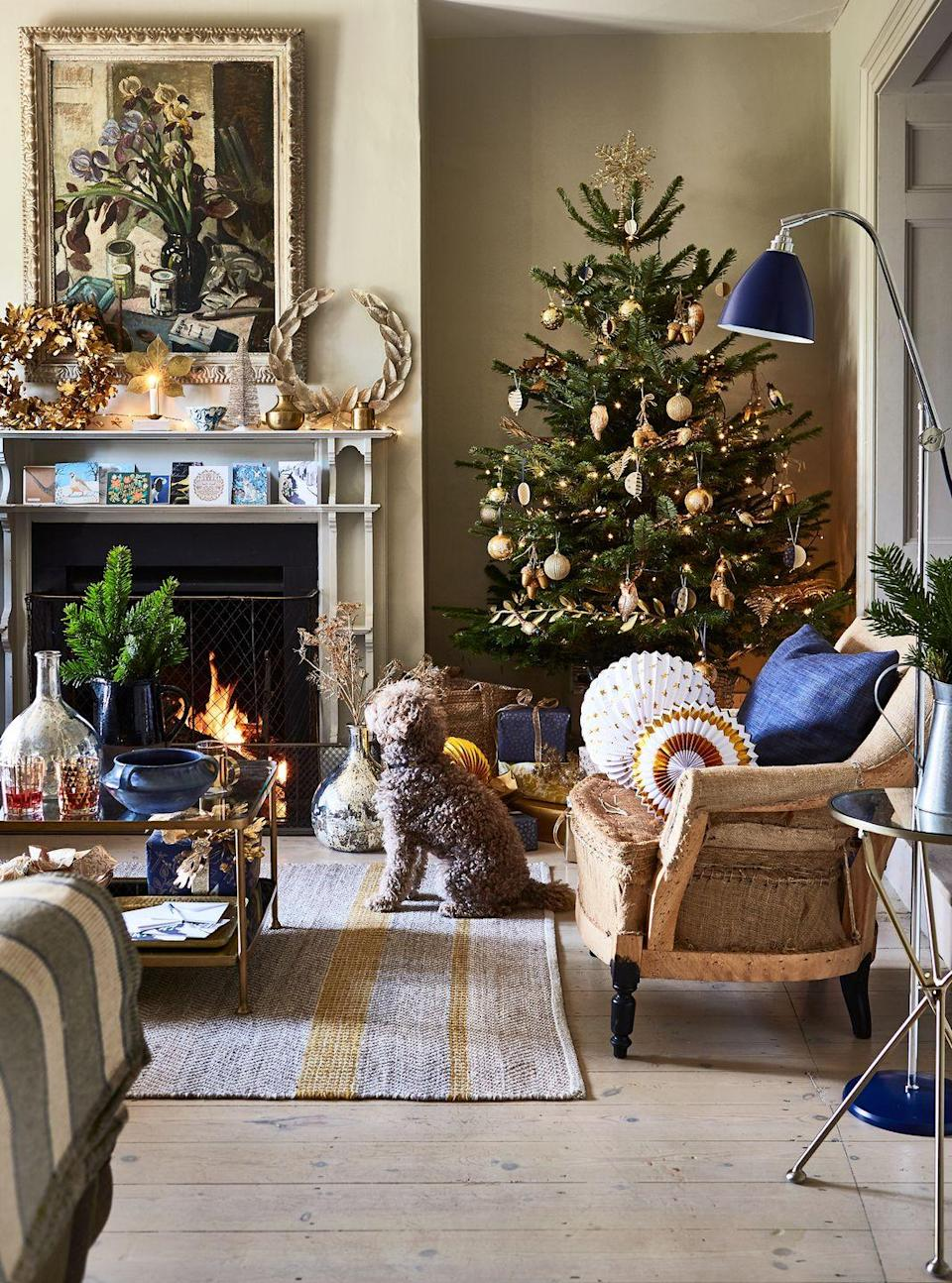 <p>Take advantage of a two-tier mantel by personalizing one level with Christmas cards and then lean some small wreaths and candles on the top. It's literally that easy when you have a designated place that actually shows them off instead of just letting them collect dust in a pile. </p>