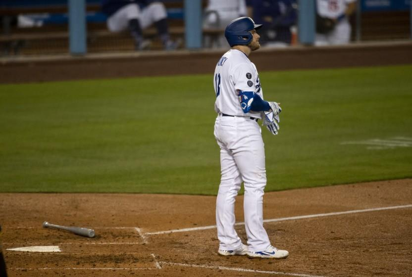 LOS ANGELES, CA - APRIL 22, 2021: Los Angeles Dodgers first baseman Max Muncy (13) stands at home plate after striking out with runners on base against the San Diego Padres in the sixth inning at Dodger Stadium on April 22, 2021 in Los Angeles, California.(Gina Ferazzi / Los Angeles Times)