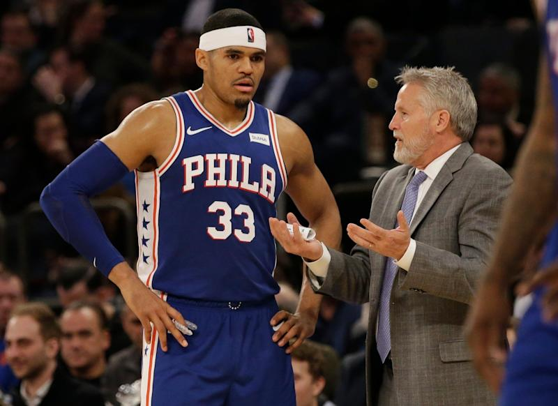 Philadelphia 76ers head coach Brett Brown, right, talks to Tobias Harris during the second half of an NBA basketball game against the New York Knicks, Wednesday, Feb. 13, 2019, in New York. The 76ers won 126-111. (AP Photo/Frank Franklin II)