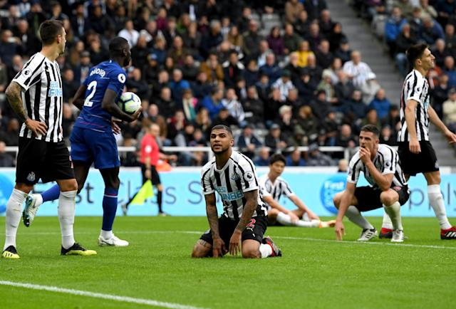 DeAndre Yedlin, center, sits in disbelief after his own goal helped Chelsea beat Newcastle. (Getty)