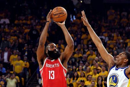 May 26, 2018; Oakland, CA, USA; Houston Rockets guard James Harden (13) shoots the ball against Golden State Warriors forward Kevon Looney (5) during the first quarter in game six of the Western conference finals of the 2018 NBA Playoffs at Oracle Arena. Mandatory Credit: Kyle Terada-USA TODAY Sports