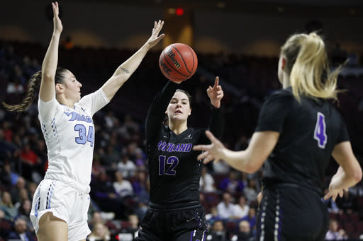 Portland's Alex Fowler (12) passes around San Diego's Patricia Brossmann (34) during the first half of an NCAA college basketball game in the final of the West Coast Conference women's tournament Tuesday, March 10, 2020, in Las Vegas. (AP Photo/John Locher)