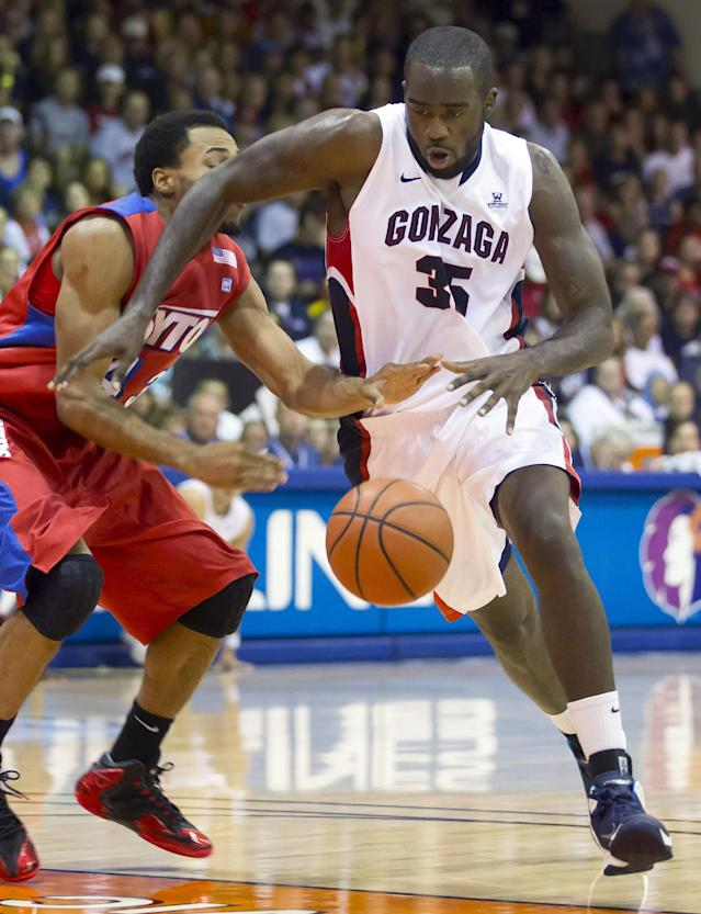 Gonzaga center Sam Dower (35) gets past Dayton guard Vee Sanford, left, and dribbles to the basket in the first half of an NCAA college basketball game at the Maui Invitational on Monday, Nov. 25, 2013, in Lahaina, Hawaii. (AP Photo/Eugene Tanner)