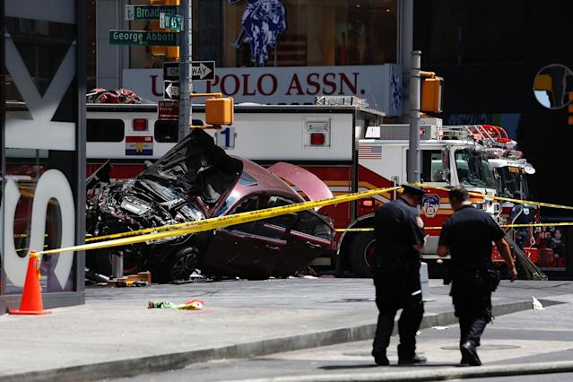 <p>A smashed car sits on the corner of Broadway and 45th Street in New York's Times Square after ploughing through a crowd of pedestrians at lunchtime on May 18, 2017. Police do not suspect a link to terrorism, and the driver was taken into custody to be tested for alcohol. (Photo: Seth Wenig/AP) </p>