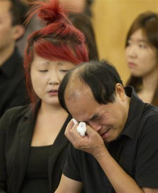 Dirang Lin, father of slain student Jun Lin is overcome during funeral services in Montreal, July 26, 2012.