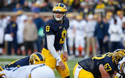 Ex-Houston QB John O'Korn is in a QB battle at Michigan. (Photo by Gregory Shamus/Getty Images)