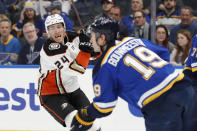 St. Louis Blues' Jay Bouwmeester (19) handles the puck as Anaheim Ducks' Carter Rowney (24) defends during the first period of an NHL hockey game Monday, Jan. 13, 2020, in St. Louis. (AP Photo/Jeff Roberson)