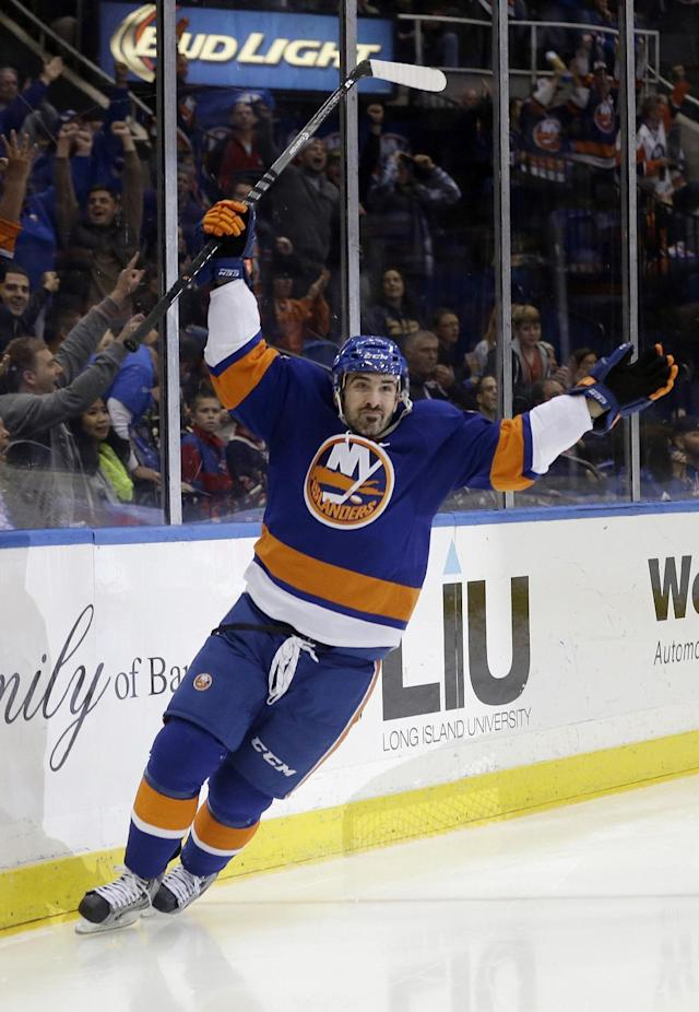 New York Islanders' Cal Clutterbuck (15) celebrates after scoring a goal during the second period of an NHL hockey against the New York Rangers game Tuesday, Oct. 29, 2013, in Uniondale, N.Y. (AP Photo/Frank Franklin II)