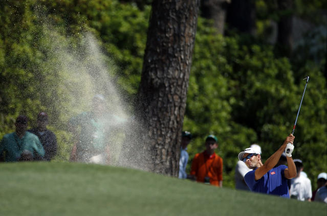 Adam Scott, of Australia, hits out of a bunker on the first fairway during the third round of the Masters golf tournament Saturday, April 12, 2014, in Augusta, Ga. (AP Photo/Matt Slocum)