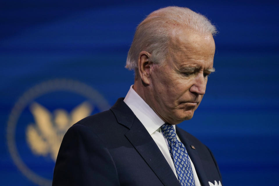 President-elect Joe Biden pauses as he speaks at The Queen Theater in Wilmington, Del., Tuesday, Dec 22, 2020. (AP Photo/Carolyn Kaster)