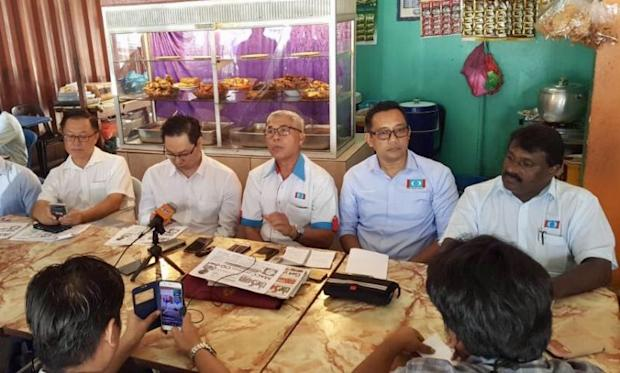 Johor PKR chief Hassan Abdul Karim (third left) said both the Home Ministry and also Royal Malaysian Police have a duty to temporary suspend Wan Ahmad from his position. ― Picture by Saiful Adli Jamian