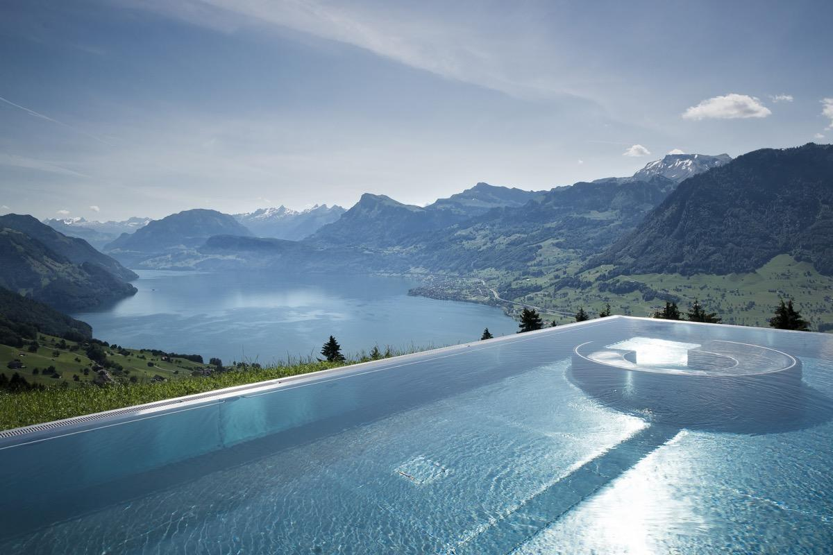 "From heated spas perched atop mountainous cliffs in the jungle to infinity pools at the apex of urban skylines, these chlorinated havens offer some of the best views in the world. (Oh, and you'll find five-star spa treatments at basically all of them.) When it comes time to book your next luxury trip, ditch the romance novel, grab your swimsuit, and dive headlong into one of these completely insane swimming pools.      <div class=""number-head-mod number-head-mod-standalone"">         <h2 class=""header-mod"">         	            	<div class=""number"">1</div> 	            <div class=""title"">Marina Bay Sands, Singapore</div>                     </h2>     </div>"