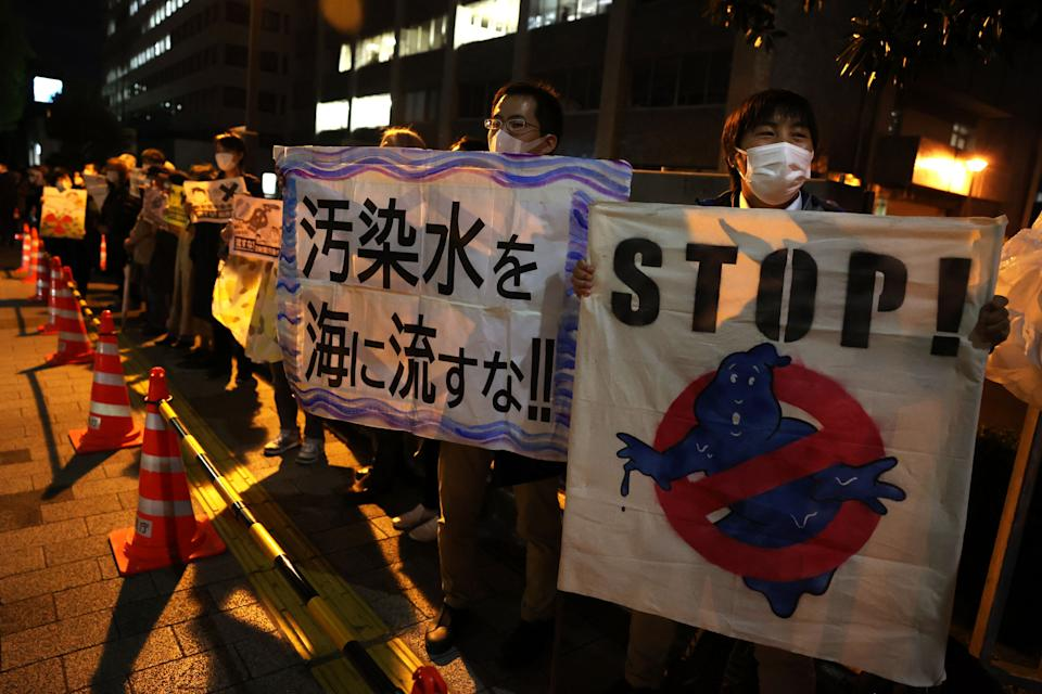 Protestors hold slogans as they take part in a rally against the Japanese government's decision to release treated water from the stricken Fukushima Daiichi nuclear plant into the sea, outside of the prime minister's office in Tokyo on April 13, 2021. (Photo by Yuki IWAMURA / AFP) (Photo by YUKI IWAMURA/AFP via Getty Images) (Photo: YUKI IWAMURA via AFP via Getty Images)