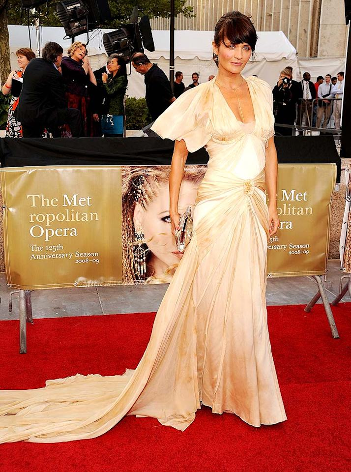 """Molly's fellow model pal Helena Christensen stole the spotlight in this gorgeous gold gown. Dimitrios Kambouris/<a href=""""http://www.wireimage.com"""" target=""""new"""">WireImage.com</a> - September 22, 2008"""
