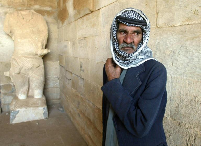Iraqi Salem Harush Kadori, 68, guards the UNESCO-listed ancient city of Hatra during the US-led invasion of 2003. Then its desert temples largely escaped the fighting but there are fears of heavy damage during three years of jihadist control