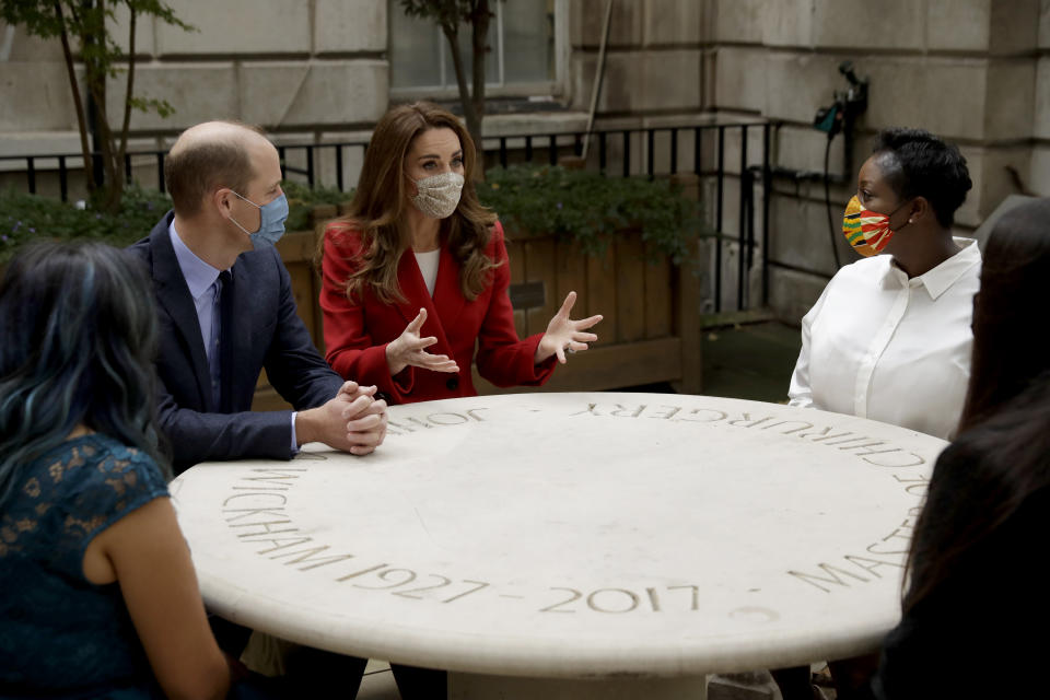 LONDON, ENGLAND - OCTOBER 20: Prince William and Catherine, Duchess of Cambridge meet pharmacist Joyce Duah, second right, and pharmacy technicians Amelia Chowdhury, right, and Dipal Samuel, left, as they visit St. Bartholomew's Hospital in London, to mark the launch of the nationwide 'Hold Still' community photography project, on October 20th, 2020 in London, England.  The Duke and Duchess of Cambridge on Tuesday met a small number of staff from the hospital, including pharmacist and photographer Joyce Duah and the two pharmacy technician colleagues Amelia and Dipal she photographed writing on their PPE as they put it on, in a photograph that was selected to be in the set of 100 images taken during the coronavirus lockdown. (Photo by Matt Dunham - WPA Pool/Getty Images)