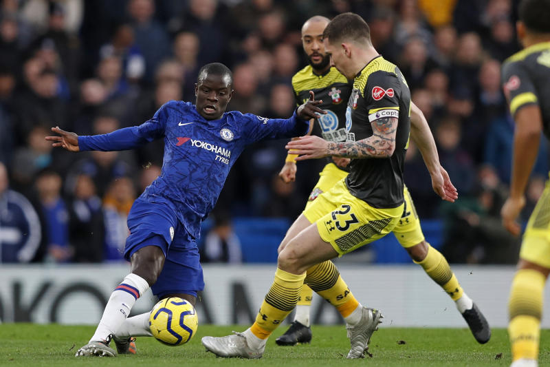 Chelsea's French midfielder N'Golo Kante (L) vies with Southampton's Danish midfielder Pierre-Emile Hojbjerg during the English Premier League football match between Chelsea and Southampton at Stamford Bridge in London on December 26, 2019. (Photo by Adrian DENNIS / AFP) / RESTRICTED TO EDITORIAL USE. No use with unauthorized audio, video, data, fixture lists, club/league logos or 'live' services. Online in-match use limited to 120 images. An additional 40 images may be used in extra time. No video emulation. Social media in-match use limited to 120 images. An additional 40 images may be used in extra time. No use in betting publications, games or single club/league/player publications. / (Photo by ADRIAN DENNIS/AFP via Getty Images)