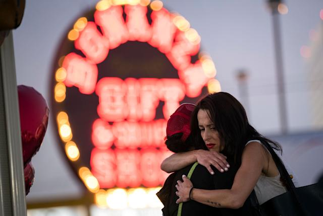 Two women hug at amakeshift memorial at the northern end of the Last Vegas Strip onWednesday.