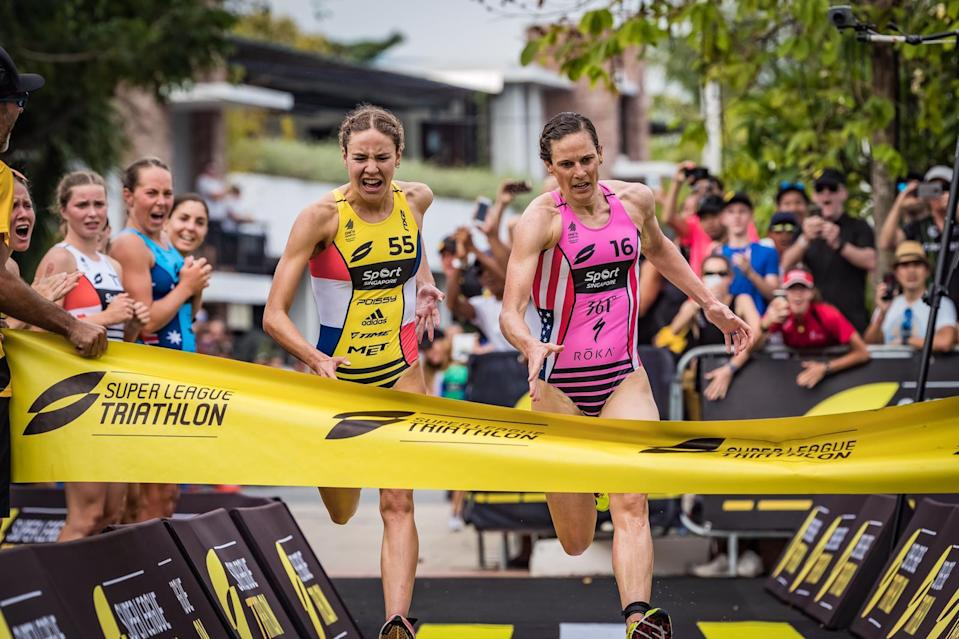 France's Cassandre Beaugrand (left) and the United States' Katie Zaferes cross the finish line for the Female Enduro race in the Singapore leg of the Super League Triathlon series at Sentosa Cove on 24 February 2019. (PHOTO: Super League Triathlon)