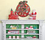"""<p>You don't need to have a traditional wreath—anything circular will do! Take, for instance, this metal tree skirt, which looks lovely tacked up on an empty wall. Old tires, cookie tins, mirror frames, and wagon wheels would also fit the bill here.</p><p><a class=""""link rapid-noclick-resp"""" href=""""https://www.amazon.com/National-Tree-Crestwood-Bristles-CW7-306-24W-1/dp/B00EC820TA?tag=syn-yahoo-20&ascsubtag=%5Bartid%7C10050.g.1247%5Bsrc%7Cyahoo-us"""" rel=""""nofollow noopener"""" target=""""_blank"""" data-ylk=""""slk:SHOP CHRISTMAS WREATHS"""">SHOP CHRISTMAS WREATHS</a></p>"""