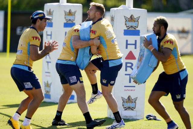 Gold Coast Titans' players of the National Rugby League train on the Gold Coast, Australia, Friday, May 15, 2020. The National Rugby League will restart its interrupted season on May 28. (Dave Hunt/AAP Image via AP)