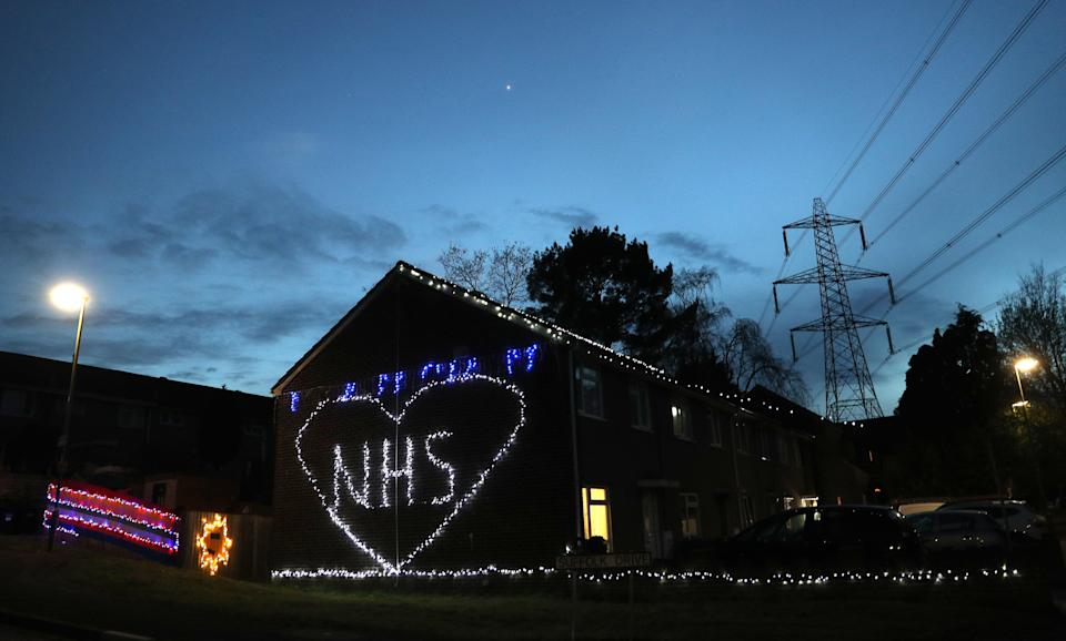 <strong>Christmas lights are used to show appreciation for the NHS on a house in Cambridge Drive in Chandler's Ford near Eastleigh, Southampton</strong> (Photo: PA)