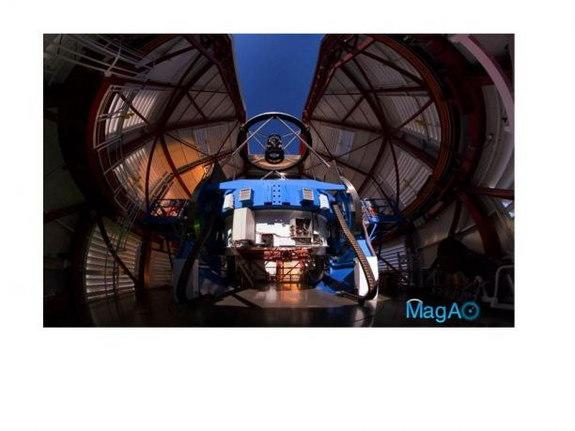 The Magellan Telescope with MagAO's Adaptive Secondary Mirror (ASM) mounted at the top looking down some 30 feet onto the 21-foot diameter primary mirror, which is encased inside the blue mirror cell. Image released Aug. 20, 2013.