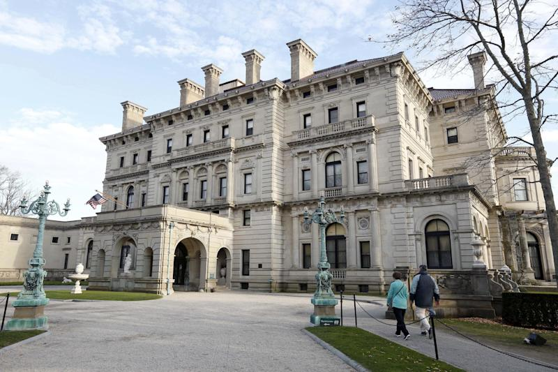 "FILE - In this Dec. 1, 2014, file photo, visitors walk toward an entrance to The Breakers mansion in Newport, R.I. Preservationists, architects and dozens of members of the Vanderbilt family have taken out an ad in a newspaper in hopes of quashing a plan to build a visitors center at The Breakers estate in Newport. The ad, which ran Thursday, Oct. 13, 2016, in Newport This Week, says the plan would ""desecrate The Breakers landscape"" and ""permanently mar this national symbol of Newport's Gilded Age.""   (AP Photo/Steven Senne, File)"