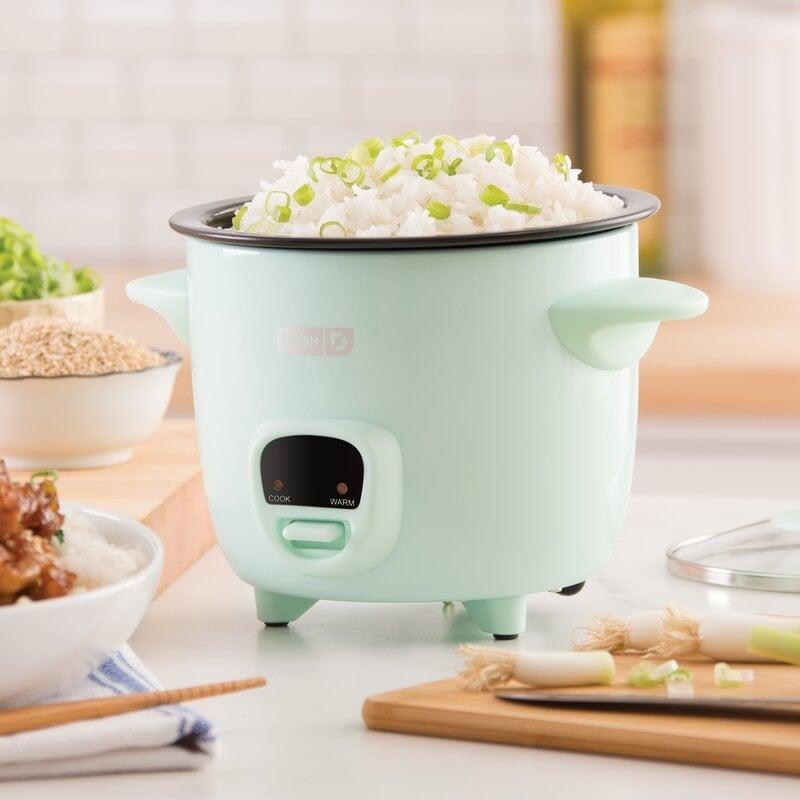 "<p>This <a href=""https://www.popsugar.com/buy/DASH-2-Cup-Mini-Rice-Cooker-579038?p_name=DASH%202%20Cup%20Mini%20Rice%20Cooker&retailer=wayfair.com&pid=579038&price=21&evar1=casa%3Aus&evar9=47575922&evar98=https%3A%2F%2Fwww.popsugar.com%2Fhome%2Fphoto-gallery%2F47575922%2Fimage%2F47575952%2FDASH-2-Cup-Mini-Rice-Cooker&list1=gadgets%2Ckitchens%2Chome%20shopping&prop13=mobile&pdata=1"" class=""link rapid-noclick-resp"" rel=""nofollow noopener"" target=""_blank"" data-ylk=""slk:DASH 2 Cup Mini Rice Cooker"">DASH 2 Cup Mini Rice Cooker</a> ($21, originally $30) is both cute and handy.</p>"