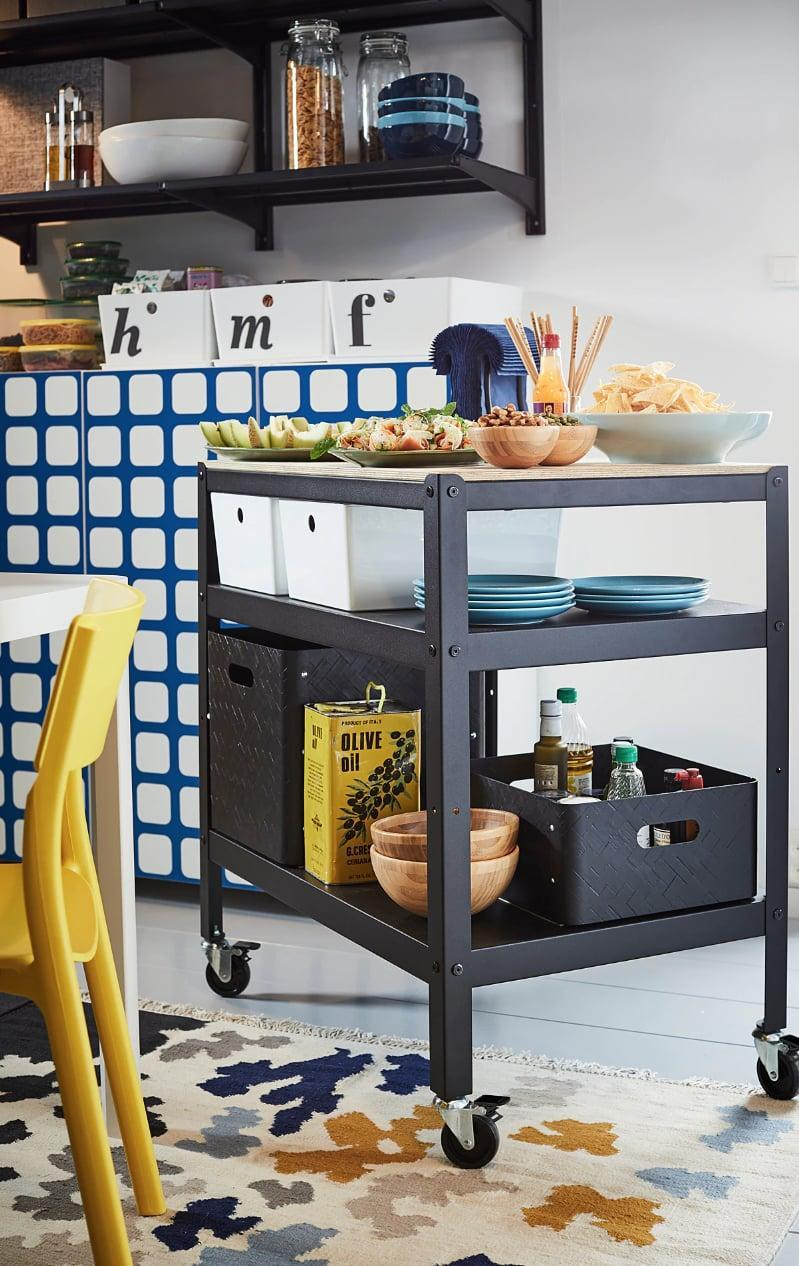 "<p>Roll out the sturdy <a href=""https://www.popsugar.com/buy/Bror%20Utility%20Cart-447001?p_name=Bror%20Utility%20Cart&retailer=ikea.com&price=99&evar1=casa%3Aus&evar9=46151613&evar98=https%3A%2F%2Fwww.popsugar.com%2Fhome%2Fphoto-gallery%2F46151613%2Fimage%2F46152190%2FBror-Utility-Cart&list1=shopping%2Cikea%2Corganization%2Ckitchens%2Chome%20shopping&prop13=api&pdata=1"" rel=""nofollow noopener"" target=""_blank"" data-ylk=""slk:Bror Utility Cart"" class=""link rapid-noclick-resp"">Bror Utility Cart</a> ($99) when you need it to help you serve food, display dishes, and prepare meals.</p>"