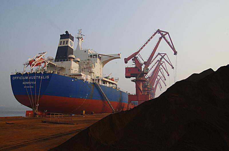 In this photo taken Thursday, May 1, 2014, cranes unload imported iron ore from a ship at a port in Rizhao in east China's Shandong province. China's trade rebounded in April from the previous month's surprise contraction but imports were subdued in another sign of the country's economic slowdown. Customs data Thursday, May 8, 2014 showed exports rose 0.9 percent, recovering from March's 6.6 percent decline. Imports rose 0.8 percent, up from the previous month's 11.3 percent decline. (AP Photo) CHINA OUT