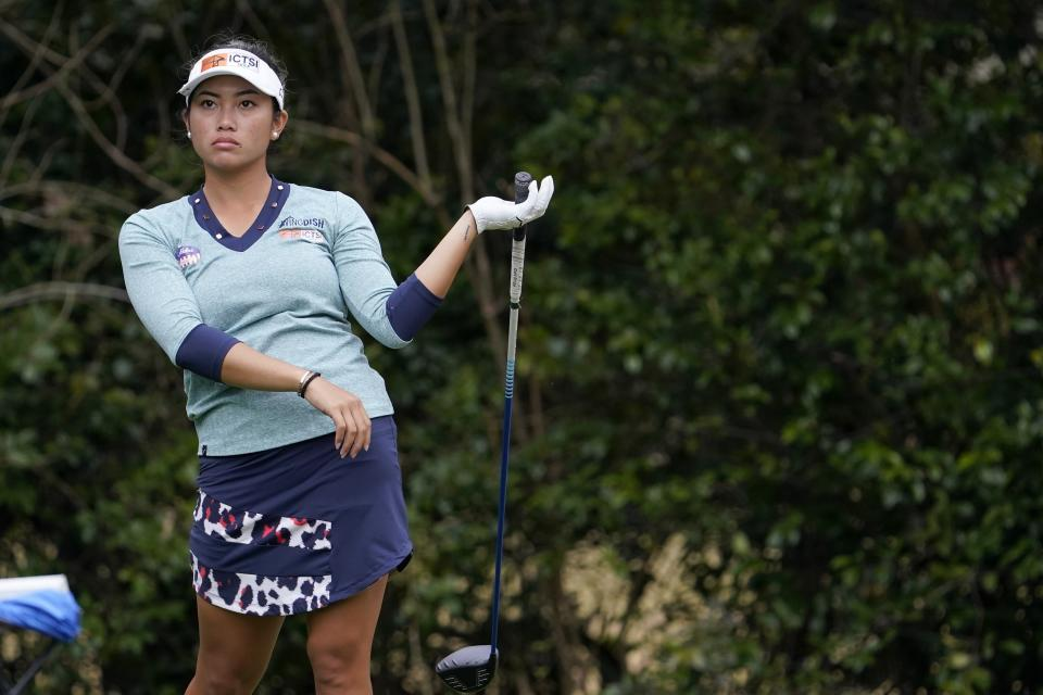 Bianca Pagdanganan, of the Philippines, releases her club after her drive off the ninth tee during the second round of the U.S. Women's Open golf tournament in Houston, Friday, Dec. 11, 2020. (AP Photo/David J. Phillip)
