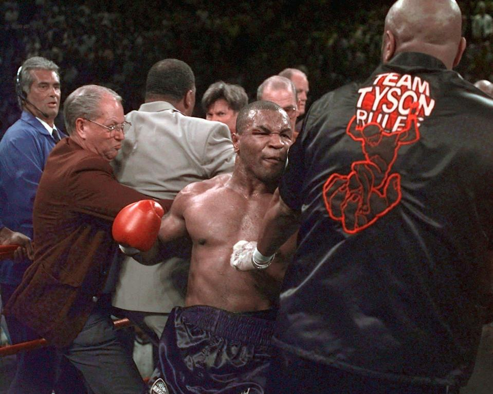 <p>Mike Tyson continues to battle in the ring after his fight against Evander Holyfield was stopped after Tyson bit Holyfield on both ears, in the third round of their WBA Heavyweight match Saturday, June 28, 1997, at the MGM Grand in Las Vegas. Tyson was disqualified and Holyfield retains his title.(AP Photo/Mark J. Terrill) </p>