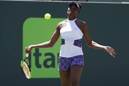 Mar 25, 2018; Key Biscayne, FL, USA; Venus Williams of the United States hits a forehand against Kiki Bertens of the Netherlands (not pictured) on day six of the Miami Open at Tennis Center at Crandon Park. Mandatory Credit: Geoff Burke-USA TODAY Sports