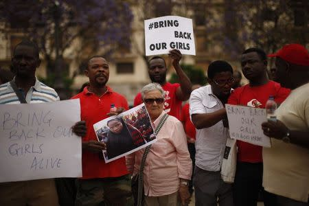 People take part in a protest, called by Malaga's Nigerian women Association, for the release of the abducted secondary school girls in the remote village of Chibok in Nigeria, in Malaga