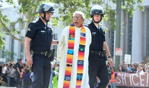 Faith leaders including Father Richard Estrada were arrested near the federal courthouse in Los Angeles, to protest a visit by US Attorney General Jeff Sessions, and the Trump administration's hard-line immigration policies