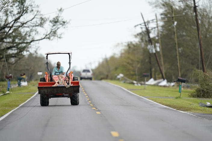 A farmer moves down a road on Friday, Aug. 28, 2020, in Homewood, La., in the aftermath of Hurricane Laura. (AP Photo/Gerald Herbert)