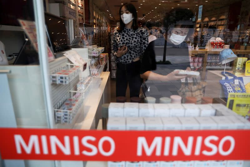 Customers shop at a store of Chinese retailer MINISO Group in Beijing