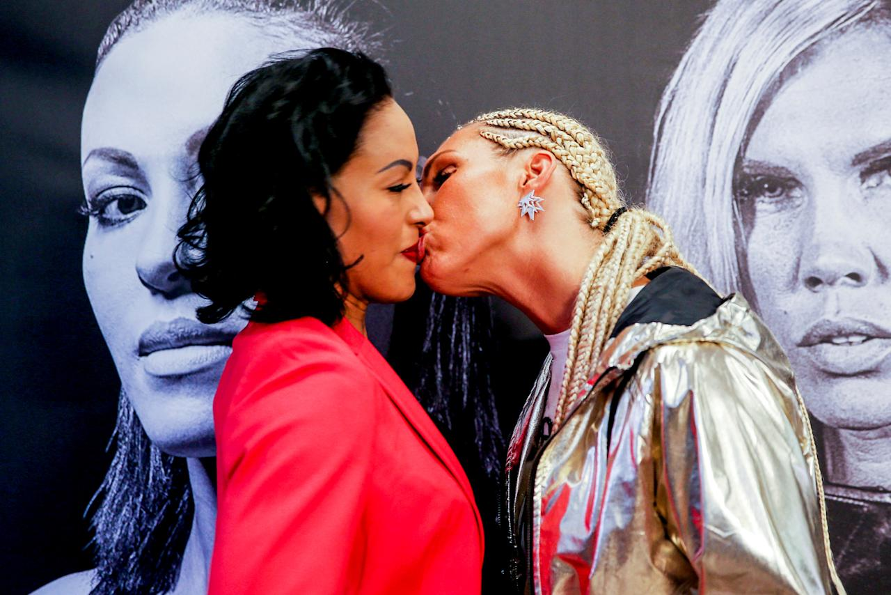 Swedish boxer Mikaela Lauren (R) kisses boxer Cecilia Braekhus of Norway during a news conference, ahead of their Oslofjord Fight Night in Oslo, Norway October 16, 2017. Picture taken October 16, 2017. NTB Scanpix/Orn E. Borgen via REUTERS TPX IMAGES OF THE DAY.   ATTENTION EDITORS - THIS IMAGE WAS PROVIDED BY A THIRD PARTY. NORWAY OUT. NO COMMERCIAL OR EDITORIAL SALES IN NORWAY. NO COMMERCIAL SALES.