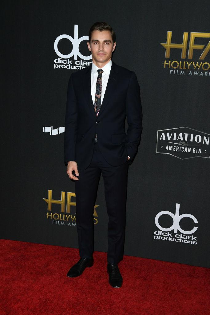 <p>The younger Franco paired a printed tie with an all black suit. (Photo: Getty Images) </p>