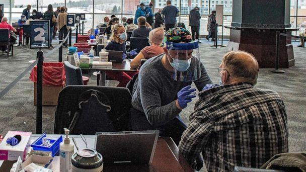 PHOTO: Medical workers provide vaccines against COVID-19 at Gillette Stadium in Foxborough, Mass., Feb. 1, 2021. (Joseph Prezioso/AFP via Getty Images, FILE)