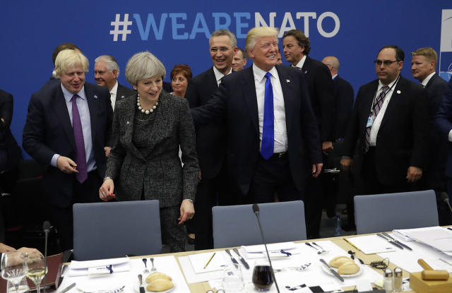<p>U.S. President Donald Trump touches the back of British Prime Minister Theresa May during a working dinner meeting at the NATO headquarters during a NATO summit of heads of state and government in Brussels on May 25, 2017. US President Donald Trump inaugurated the new headquarters during a ceremony with other heads of state and government. (Photo: Matt Dunham/AP) </p>