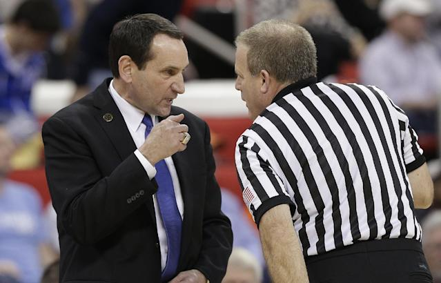 Duke head coach Mike Krzyzewski speaks to an official during the first half of an NCAA college basketball second-round game against Mercer, Friday, March 21, 2014, in Raleigh, N.C. (AP Photo/Chuck Burton)