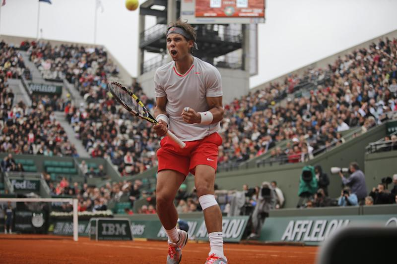 Spain's Rafael Nadal clenches his fist after scoring a point against Slovakia's Martin Klizan in their second round match at the French Open tennis tournament, at Roland Garros stadium in Paris, Friday, May 31, 2013. Nadal won in four sets 4-6, 6-3, 6-3, 6-3. (AP Photo/Michel Spingler)