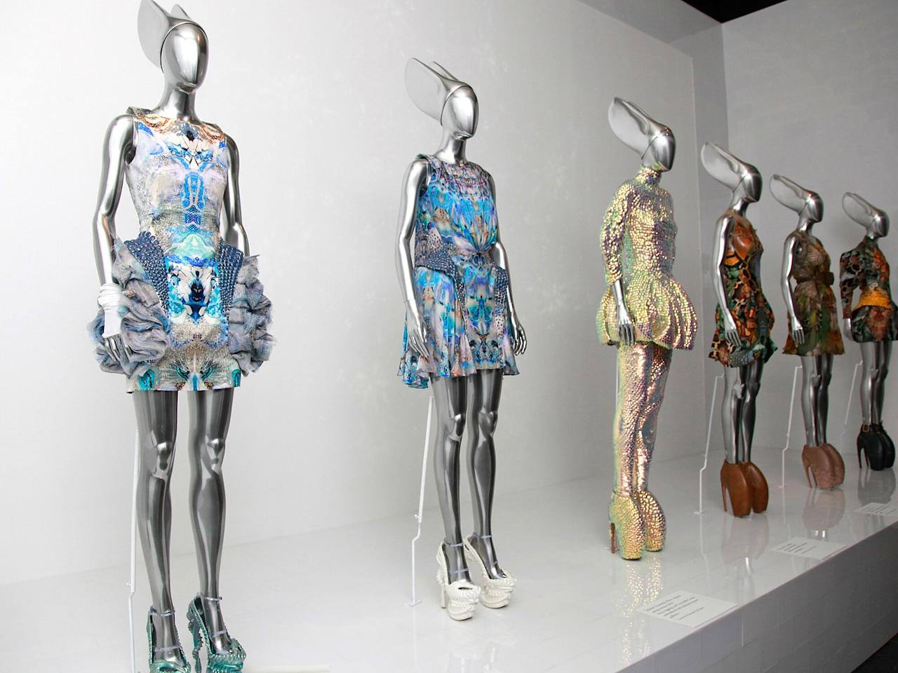 """Just over a year after the death of Alexander McQueen, the Met's Costume Institute honored the brilliant young designer with """"Savage Beauty,"""" an exhibit of his work that launched at the Met Gala. The collection included """"manta dresses,"""" pictured, from McQueen's final show, SS 2010's """"Plato's Atlantis"""" — some pieces from which had also been used in Lady Gaga's """"Bad Romance"""" video."""