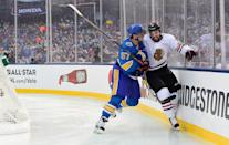 <p>ST LOUIS, MO – JANUARY 02: David Perron #57 of the St. Louis Blues checks Michal Kempny #6 of the Chicago Blackhawks near the end boards during the 2017 Bridgestone NHL Winter Classic at Busch Stadium on January 2, 2017 in St Louis, Missouri. (Photo by Patrick McDermott/NHLI via Getty Images) </p>